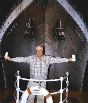 PhotoCredit: Crook Publicity, Australian billionaire Clive Palmer poses in front of an artist impression of the Titanic ll at MGM Studios in Los Angeles, Calif.