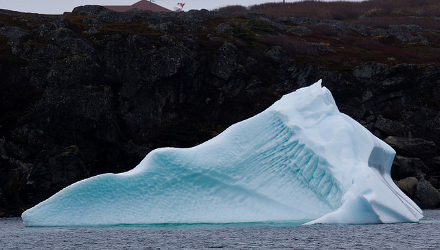 Caught on tape, iceberg flips over