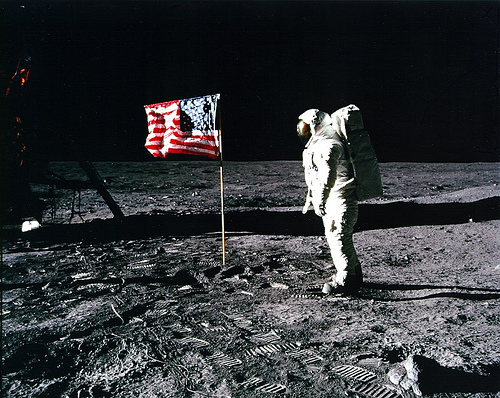Armstrong on moon with the flag