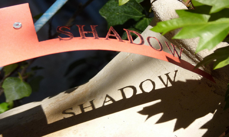 Leaf and a banner both have a shadow