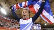 Sir Chris Hoy celebrates his sixth olympic gold medal