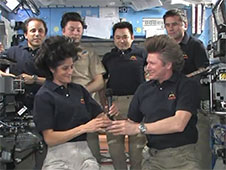 Gennady Padalka ceremonially hands control of the International Space Station to Suni Williams. PhotoCredit: NASA TV