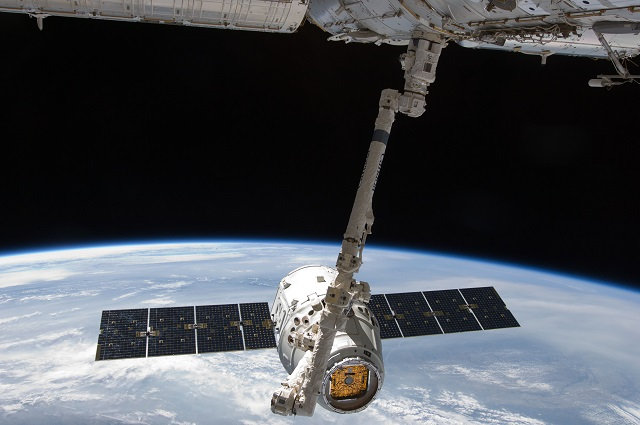 A SpaceX Dragon cargo capsule was captured by the International Space Station's robot arm early Sunday.