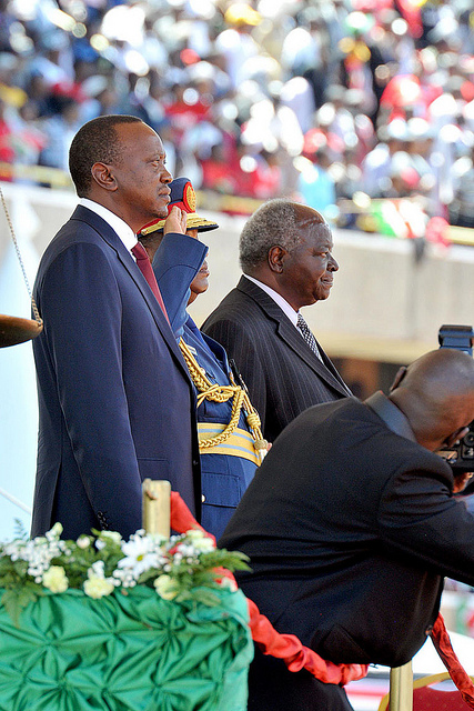President elect Uhuru Kenyatta(left) and outgoing President Mwai Kibaki observing the National Salute during the inauguration ceremony held at the Kasarani sports complex in Nairobi, Kenya.